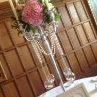 Arley hall centerpiecs on tall candleabra