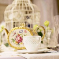 BIRDCAGES AND TEA SET SETTING VINTAGE STYLE