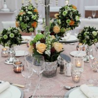 CANDLEABRA WITH PEACH POM POM ARRANGEMENTS