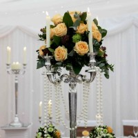 TALL CANDLEABRA WITH PEACH ROSES AND PEARLS £90 UPWARDS